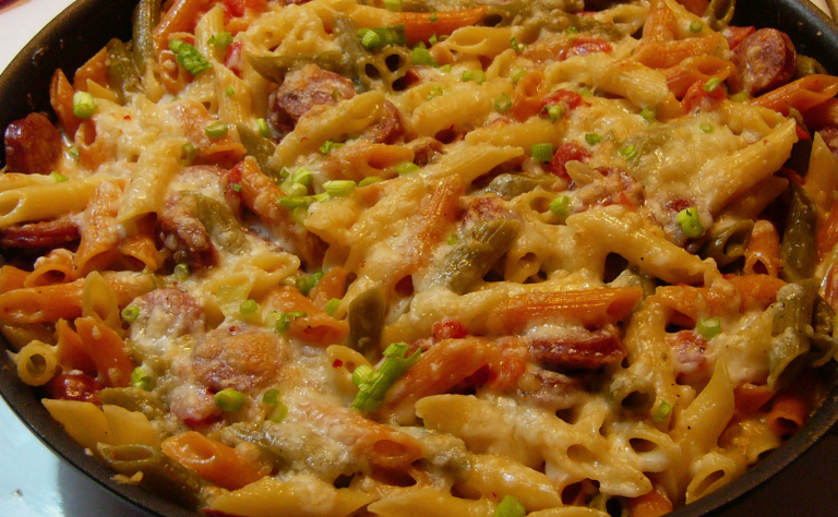 Spicy Sausage Pasta with Mexican Tortilla Salad and AvocadoDressing