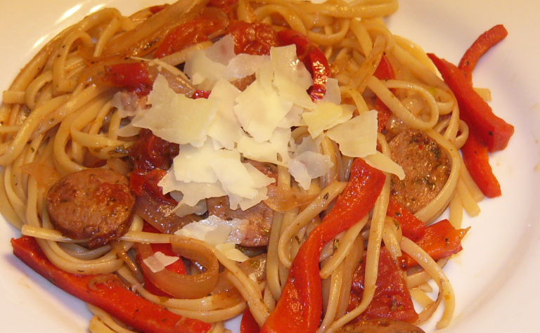 Onions, Peppers and Italian Sausage over Linguine