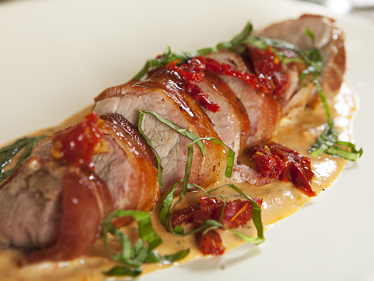 Bacon-Wrapped Pork with Sun-Dried Tomato and Basil BeurreBlanc