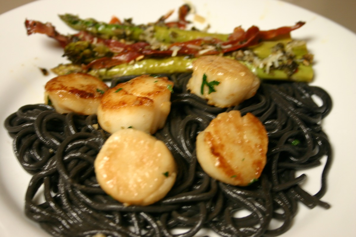 Seared Scallops Over Squid Ink Spaghetti